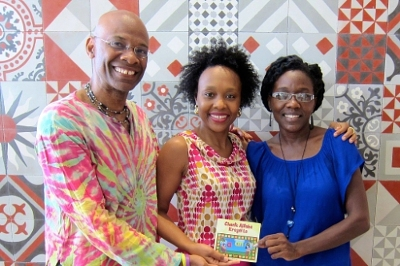 Professor Michel DeGraff Marie Rodny Laurent and Ann Timothee Milfort Holding the newly released DVD of the kreyol alphabet. Photo Credit: PR Newsire